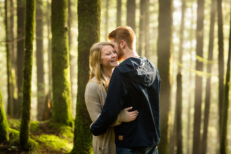 engaged couple hugging in the forest at Golden Ears Park