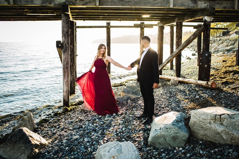 Couple dancing on beach during engagement session